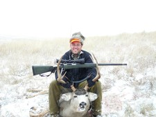 Scott from Florida -- Scott's first mule deer during the 2008 South Dakota deer season.