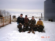 The gang with turkey's and pheasants in a December late season hunt at Antler Ridge Lodge.